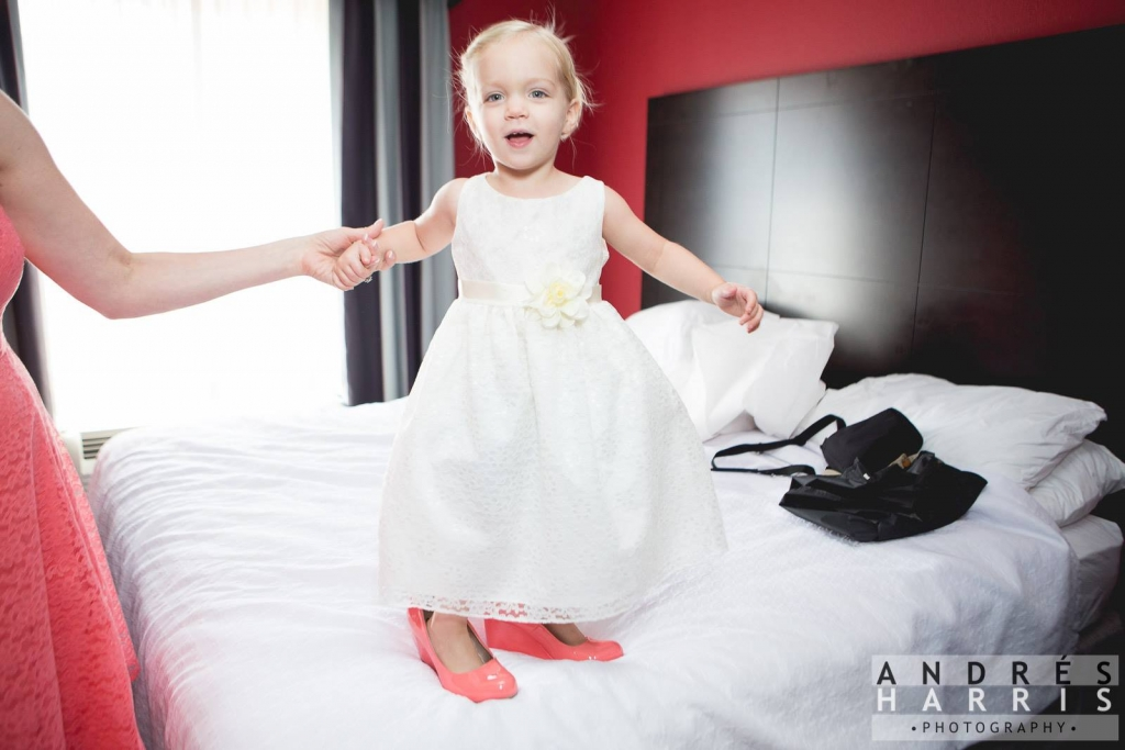 flower girl in bride's shoes