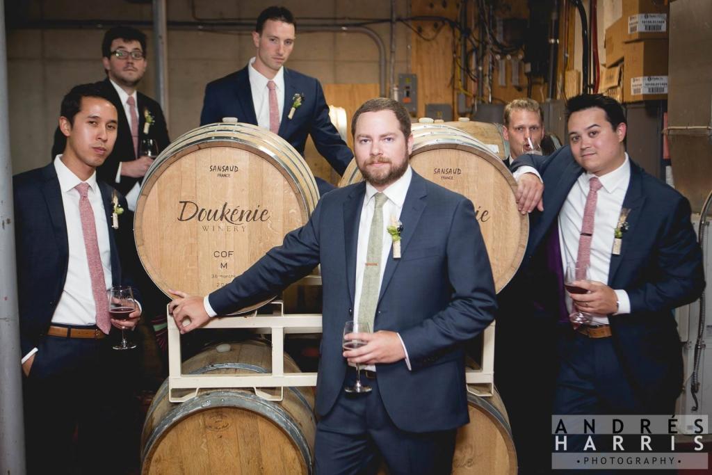 Groom and groomsmen in wine cellar