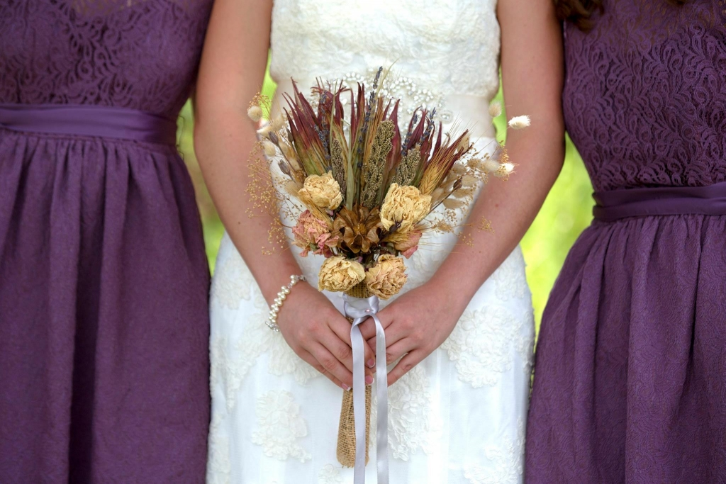 Dried bouquets and purple bridesmaids
