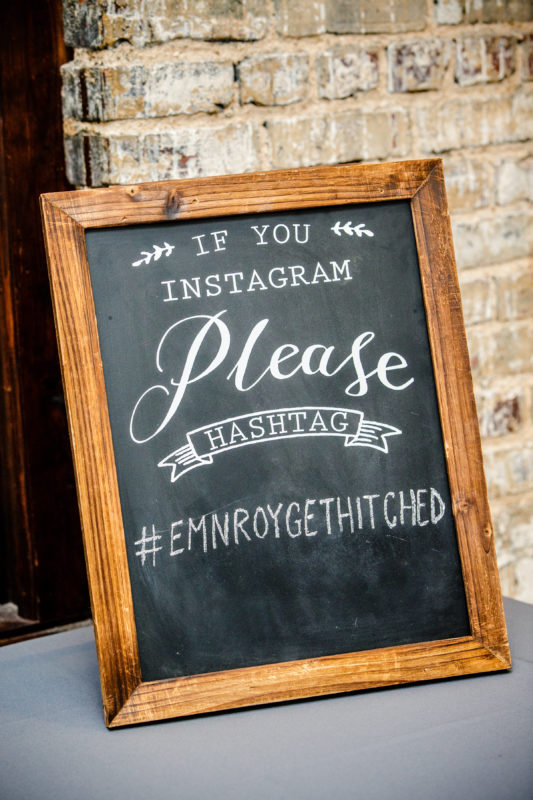 Chalkboard wedding sign hashtag