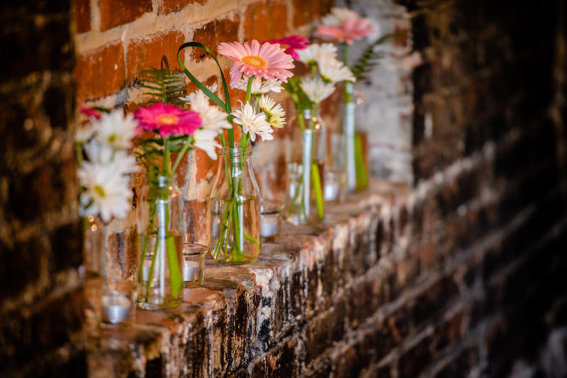Bud vases on exposed brick